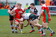 Keighley Cougars loose forward Mike Emmett (13) is held in the tackle during the Betfred League 1 match between Keighley Cougars and Bradford Bulls at Cougar Park, Keighley, United Kingdom on 11 March 2018. Picture by Simon Davies.