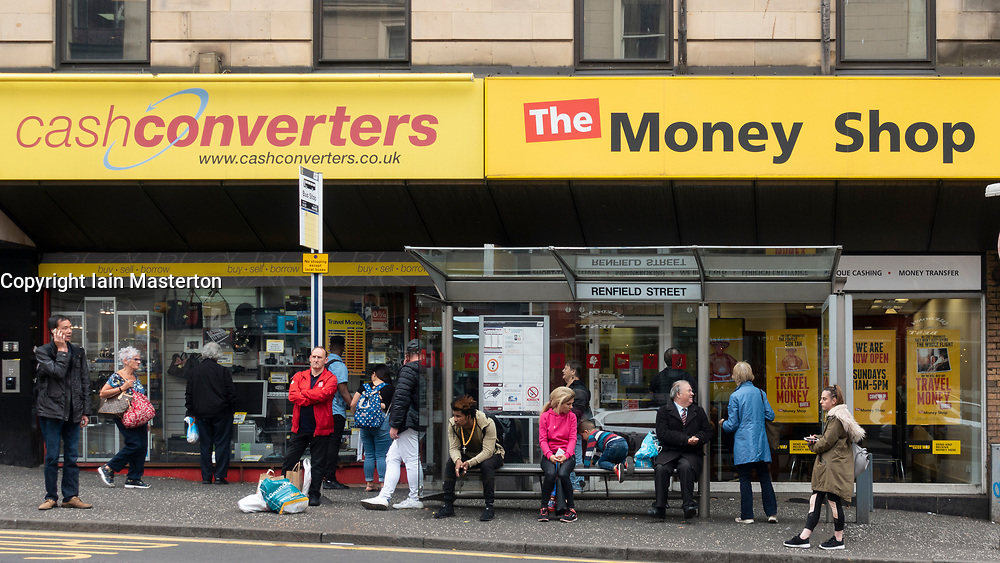 Exterior of two shops dealing in low cost cash services, CashConverters and The Money Shop in central Glasgow, Scotland, UK