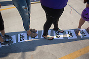 Paticipants of BobcaThon's cake walk make their way along numbered spaces layed out through the Baker Center parking lot on October 5, 2016. Whenever a number was called, the person standing on that space won a cake.