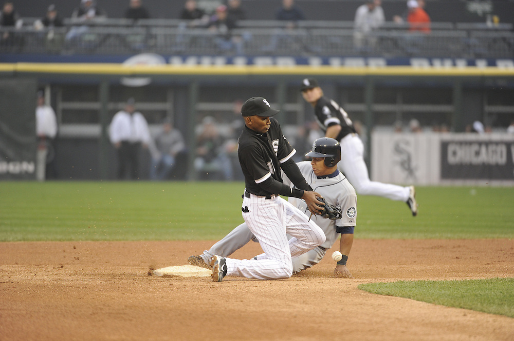 CHICAGO - APRIL 24:  Alexei Ramirez #10 of the Chicago White Sox can't catch the ball as Jose Lopez #4 of the Seattle Mariners steals second base on April 24, 2010 at U.S. Cellular Field in Chicago, Illinois.  The White Sox defeated the Mariners 5-4.  (Photo by Ron Vesely)