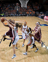 UVA's Brenna McGuire (10) defends against VT's Kirby Copeland (5).  The Virginia Tech Hokies overcame a 14 point Virginia lead to beat the Cavaliers 60-58 on their home court at the John Paul Jones Arena in Charlottesville, VA.