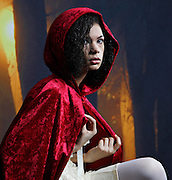 A model dressed as little red riding hood