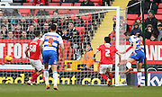 Reading striker Yann Kermorgant (29) scores to make it 1-0 to Reading during the Sky Bet Championship match between Charlton Athletic and Reading at The Valley, London, England on 27 February 2016.