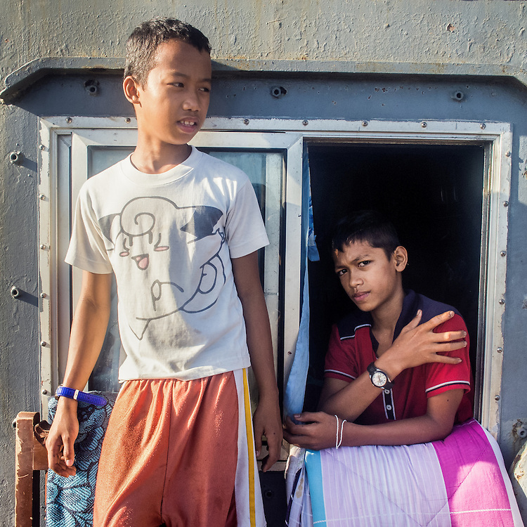 Juderick (14) and Ace (13).  Their families have found refuge inside a DPWH government ship washed away onto land by the typhoon.