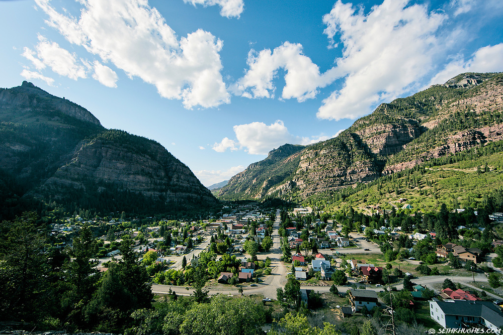 The town of Ouray, Colorado in the summertime as seen from a scenic overlook.