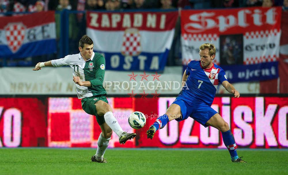 OSIJEK, CROATIA - Tuesday, October 16, 2012: Wales' Gareth Bale in action against Croatia's Ivan Rakitic during the Brazil 2014 FIFA World Cup Qualifying Group A match at the Stadion Gradski Vrt. (Pic by David Rawcliffe/Propaganda)