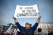 2013/03/23 Roma, manifestazione del PDL Popolo della Liberta'. Nella foto un supporter.<br /> Rome, Popolo della Liberta' (reading The Peolple of Freedom Party) demo. In the picture a supporter holds a note reading ' I trust in Silvio (Berlusconi) the Almighty  - &copy; PIERPAOLO SCAVUZZO