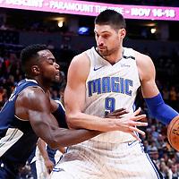 11 November 2017: Denver Nuggets forward Paul Millsap (4) defends on Orlando Magic center Nikola Vucevic (9) during the Denver Nuggets 125-107 victory over the Orlando Magic, at the Pepsi Center, Denver, Colorado, USA.