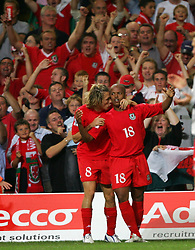 CARDIFF, WALES - Wednesday, September 8, 2004: Wales' Robert Earnshaw celebrates with Craig Bellamy after score the equalising goal against Northern Ireland during the Group Six World Cup Qualifier at the Millennium Stadium. (Pic by David Rawcliffe/Propaganda)
