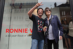 © licensed to London News Pictures. London, UK 13/08/2012. Ronnie Wood (L) and Bernie Chase posing outside the 'A Major Retrospective Of 50 Years Of Rock And Roll' exhibition in central London.  Photo credit: Tolga Akmen/LNP