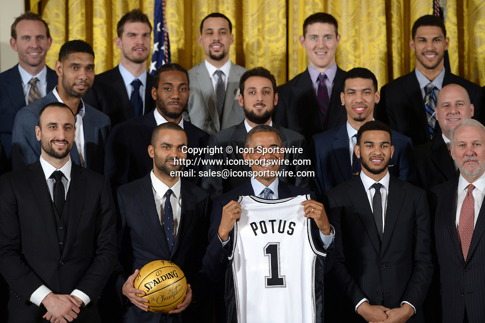 WASHINGTON D.C., Jan. 12, 2015 U.S. President Barack Obama (C) poses for group photos with members and coaches of San Antonio Spurs during an event honoring the 2014 NBA champions the San Antonio Spurs in the East Room of the White House in Washington D.C., the United States, on Jan. 12, 2015.