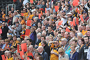 Hull City Fans hold up red cards as a protest at the clubs new membership scheme before during the Sky Bet Championship match between Hull City and Rotherham United at the KC Stadium, Kingston upon Hull, England on 7 May 2016. Photo by Ian Lyall.