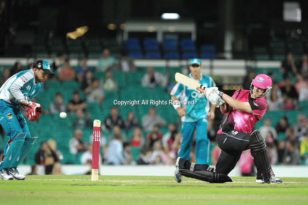 16.12.2011 Sydney, Australia. Sydney Sixers batsman Nic Maddinson in action during the KFC T20 Big Bash League game between Sydney Sixers and Brisbane Heat at the Sydney Cricket Ground.