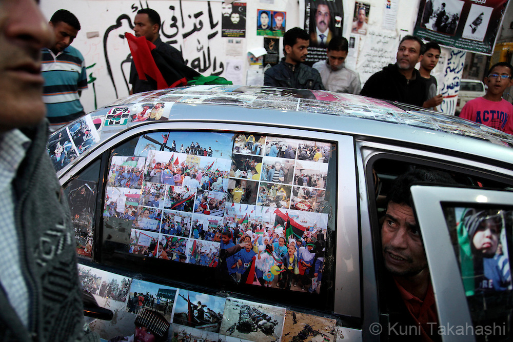 "Pictures of ""memories of resistance"" against Col. Muammar Qaddafi are posted on the car parked at the Revolution Square in Benghazi, Libya on May 30, 2011..Photo by Kuni Takahashi.."