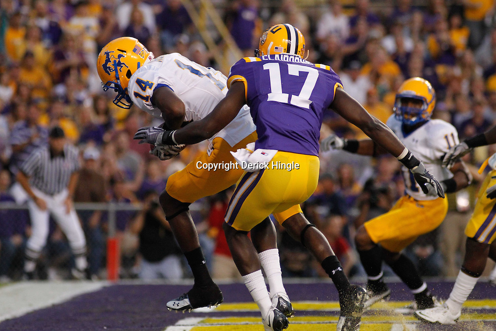 October 16, 2010; Baton Rouge, LA, USA; McNeese State Cowboys wide receiver Damion Dixon (14) catches a touchdown past LSU Tigers cornerback Morris Claiborne (17) during the first half at Tiger Stadium.  Mandatory Credit: Derick E. Hingle