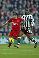 Fotball<br /> Premier League England 2004/2005<br /> Foto: SBI/Digitalsport<br /> NORWAY ONLY<br /> <br /> Liverpool v Newcastle<br /> 19/12/2004<br /> <br /> Milan Baros of Liverpool races away from Titus Bramble of Newcastle.