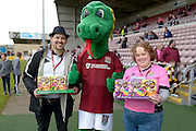 Cobblers mascot Clarence the Dragon with Easter eggs for the kids during the Sky Bet League 2 match between Northampton Town and Newport County at Sixfields Stadium, Northampton, England on 25 March 2016. Photo by Dennis Goodwin.