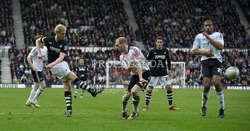 DERBY, ENGLAND - Saturday, March 12, 2011: Swansea City's Alan Tate shoots against Derby County during the Football League Championship match at Pride Park. (Photo by David Rawcliffe/Propaganda)