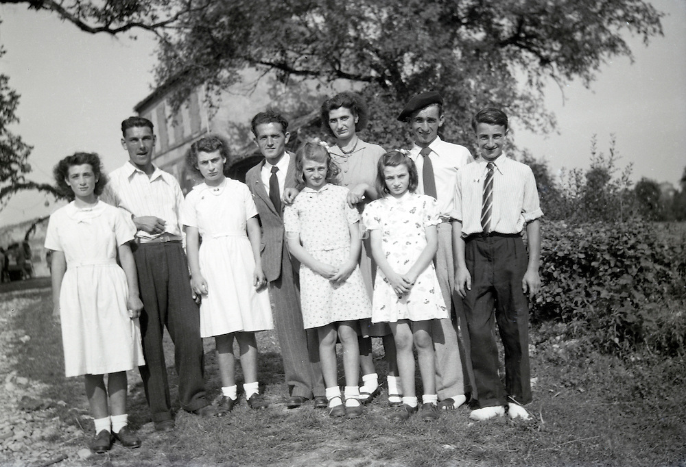 large family posing in rural landscape