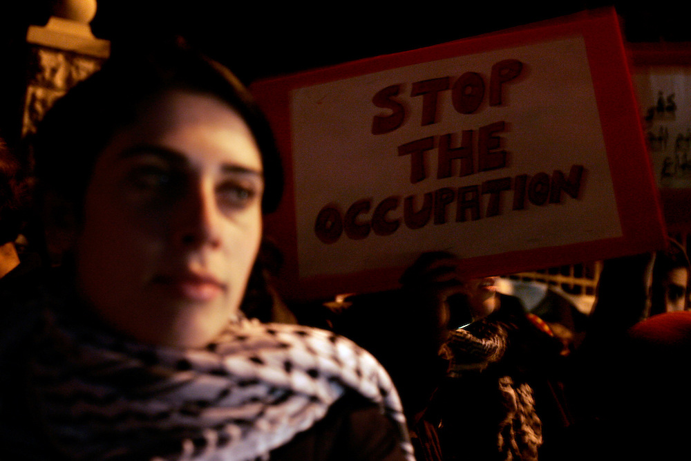 Israeli left-wing activists take part in a protest outside the residence of Israel's Prime Minister Ehud Olmert in Jerusalem, against Israel's offensive in Gaza January 1, 2009.  Photo by Olivier Fitoussi ..