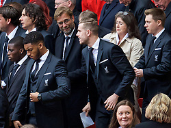 LIVERPOOL, ENGLAND - Friday, April 15, 2016: Liverpool's manager Jürgen Klopp gives captain Jordan Henderson the giggles during the 27th Anniversary Hillsborough Service at Anfield. (Pic by David Rawcliffe/Propaganda)