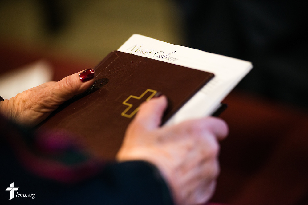 A parishioner holds a Lutheran Service Book on Sunday, April 12, 2015, at Mount Calvary Lutheran Church in Holdrege, Neb. LCMS Communications/Erik M. Lunsford