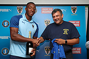 AFC Wimbledon defender Paul Kalambayi (30) receiving man of match award during the EFL Sky Bet League 1 match between AFC Wimbledon and Accrington Stanley at the Cherry Red Records Stadium, Kingston, England on 17 August 2019.