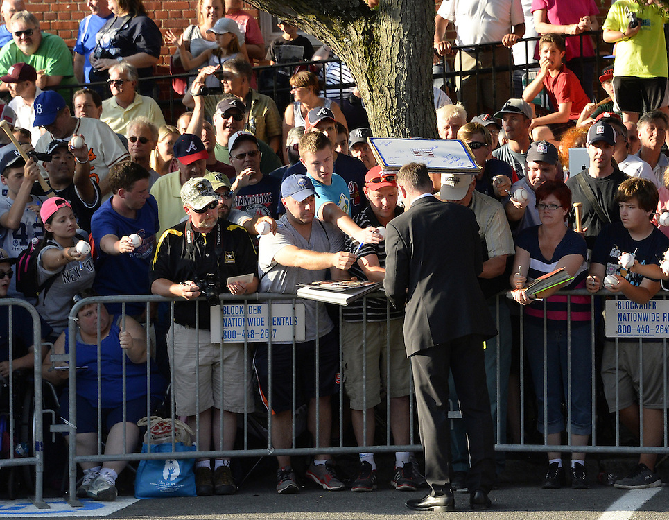 COOPERSTOWN, NY - JULY 26:  Hall of Famer Paul Molitor signs autographs during the annual Parade of Legends down Main Street in Cooperstown, New York on July 26, 2014.