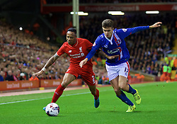 LIVERPOOL, ENGLAND - Wednesday, September 23, 2015: Liverpool's Nathaniel Clyne in action against Carlisle United's Alex Gilliead during the Football League Cup 3rd Round match at Anfield. (Pic by David Rawcliffe/Propaganda)