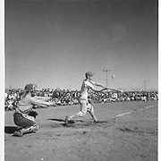 The 1944 league baseball season got under way at the Tule Lake Segregation Center on April 19. Project Director Ray R. Best tossed out the first ball. Nearly half of the 17,000 residents of the center were present for the opening game. -- Newell, California. 4/19/44<br /> Identifier:<br /> Volume 34<br /> Identifier:<br /> Section D<br /> Identifier:<br /> WRA no. G-566<br /> Collection:<br /> War Relocation Authority Photographs of Japanese-American Evacuation and Resettlement Series 11: Tule Lake<br /> Contributing Institution:<br /> The Bancroft Library. University of California, Berkeley.