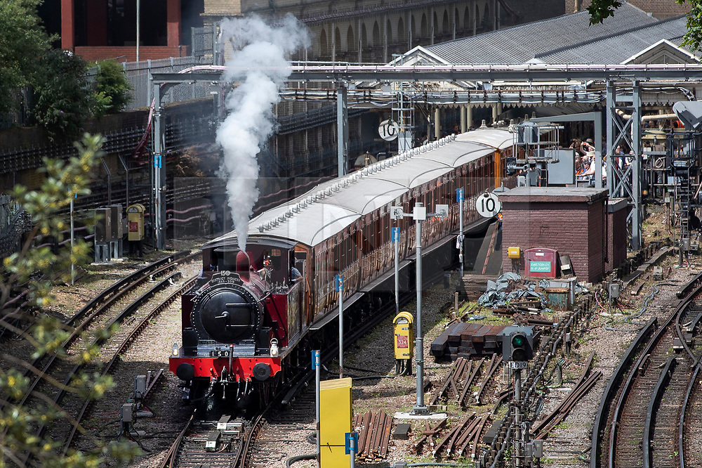 © Licensed to London News Pictures. 22/06/2019. London, UK. A Metropolitan Locomotive No 1 steam engine pulls a set of vintage coaches on the District Line out of High Street Kensington Undergound station to celebrate the 150th anniversary of the line. London Transport Museum is running steam services, with vintage coaches, between Ealing Broadway and High Street Kensington over this weekend. Photo credit: Peter Macdiarmid/LNP