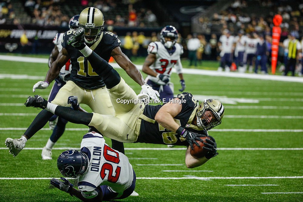 Aug 26, 2017; New Orleans, LA, USA; New Orleans Saints tight end Braedon Bowman (46) is hit by Houston Texans safety K.J. Dillon (20), the gain was negated by a offensive penalty during the second half of a preseason game at the Mercedes-Benz Superdome. The Saints defeated the Texans 13-0. Mandatory Credit: Derick E. Hingle-USA TODAY Sports