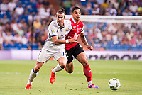 Real Madrid's player Gareth Bale and Stade de Reims's player Rigonato during the XXXVII Santiago Bernabeu Trophy in Madrid. August 16, Spain. 2016. (ALTERPHOTOS/BorjaB.Hojas)