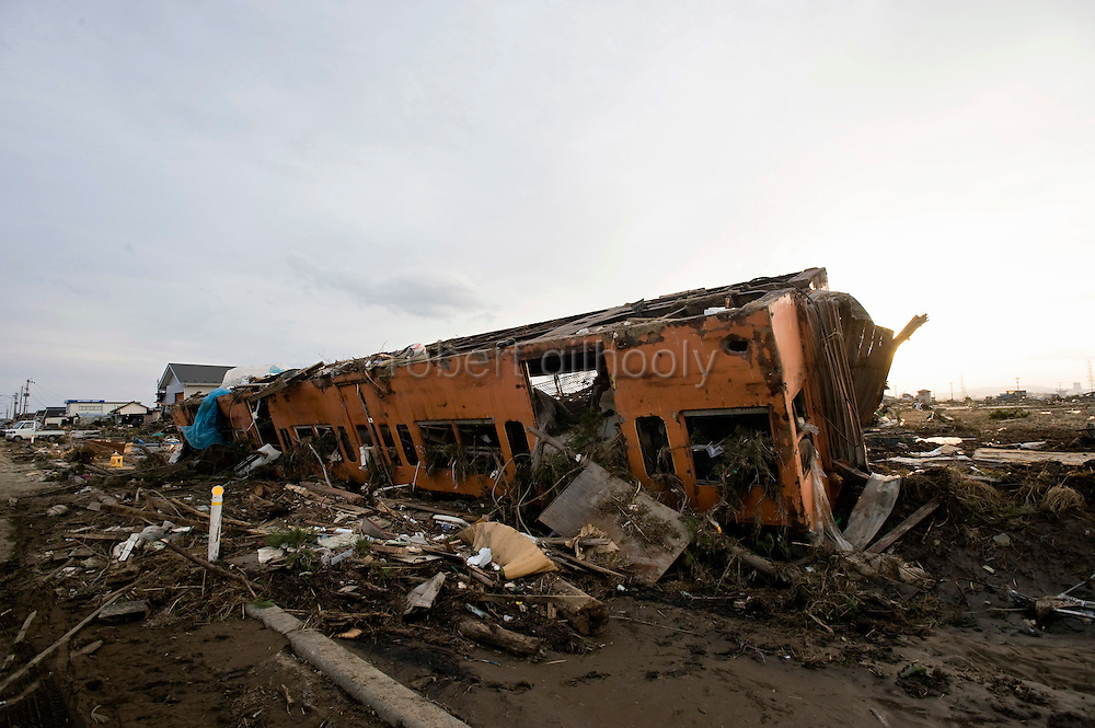The carriage of a train lies in a field of debris from the mega-tsunami that followed the March 11 magnitude 9 quake in Sendai, Miyagi Prefecture, Japan on 13 March, 2011. The nearest train station is aseveral km away. Photographer: Robert Gilhooly