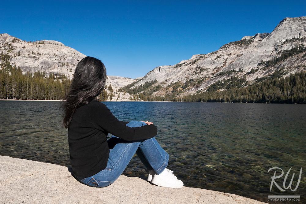 Female Sitting on Tenaya Lake Shoreline, Yosemite National Park, California