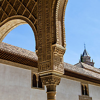 Vista del denominado patio de los arrayanes, de la alberca o de Comares, en el fondo se contempla el torreón de Comares. La Alhambra es una ciudad palatina andalusí situada en Granada, España. Formada por un conjunto de palacios, jardines y fortaleza que albergaba una verdadera ciudadela dentro de la propia ciudad de Granada, que servía como alojamiento al monarca y a la corte del Reino nazarí de Granada, Andalucia. España. View of the courtyard of the myrtles called, the pool or Comares, in the background the tower of Comares is contemplated. Alhambra is a palace and fortress complex located in Granada, Andalusia, Spain. It was originally constructed as a small fortress in 889 and then largely ignored until its ruins were renovated and rebuilt in the mid-11th century by the Moorish emir Mohammed ben Al-Ahmar of the Emirate of Granada, who built its current palace and walls. It was converted into a royal palace in 1333. Granada. Andalusia. Spain