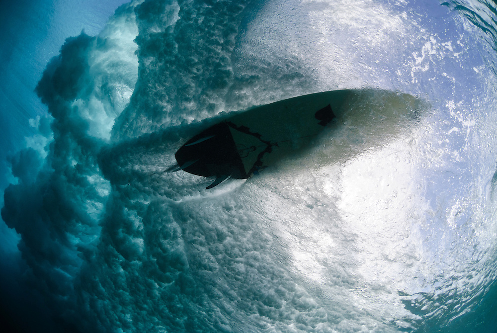 Waves break in shallow water, when the base can no longer support the top of the wave.  The Maldives are exposed to swell on either side of the atolls according to the monsoon direction. The Maldives have now become popular with surfers.
