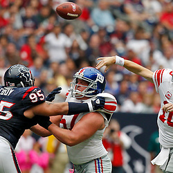 October 10, 2010; Houston, TX USA; New York Giants offensive tackle Adam Koets (61) blocks Houston Texans defensive tackle Shaun Cody (95) and quarterback Eli Manning (10) throws a pass during the first half at Reliant Stadium. Mandatory Credit: Derick E. Hingle