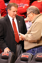 16 November 2014:  Athletic Director Larry Lyons speaks with a fan during an NCAA non-conference game between the Utah State Aggies and the Illinois State Redbirds.  The Aggies win the competition 60-55 at Redbird Arena in Normal Illinois.
