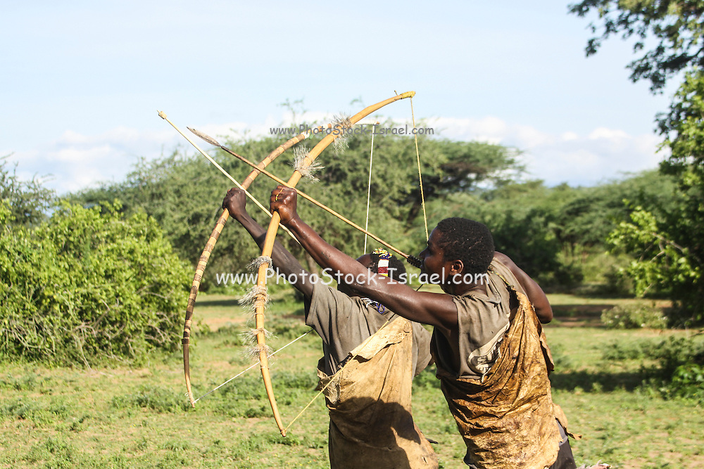 Africa, Tanzania, Lake Eyasi, Hadza hunters AKA Hadzabe Tribe practice with bow and arrows