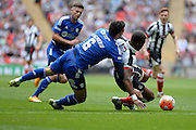 Grimsby Town striker Omar Bogle takes a tackle during the FA Trophy match between Grimsby Town FC and Halifax Town at Wembley Stadium, London, England on 22 May 2016. Photo by Dennis Goodwin.