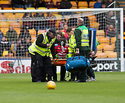 28th April 2018, Fir Park, Motherwell, Scotland; Scottish Premier League football, Motherwell versus Dundee; Genseric Kusunga of Dundee with oxygen mask after collapsing as the second half was about to start