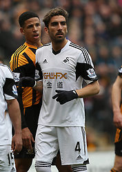 Swansea's Chico Flores sports a new hair cut - Photo mandatory by-line: Matt Bunn/JMP - Tel: Mobile: 07966 386802 05/04/2014 - SPORT - FOOTBALL - KC Stadium - Hull - Hull City v Swansea City- Barclays Premiership