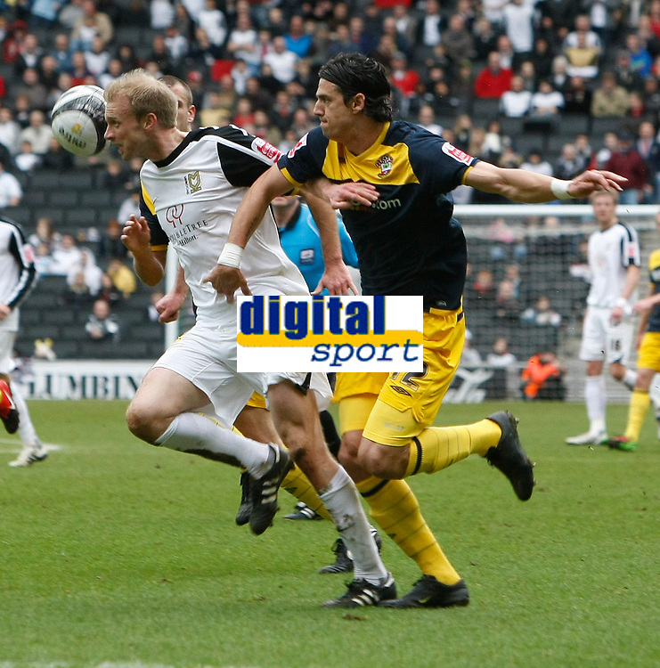 Photo: Steve Bond/Richard Lane Photography. MK Dons v Southampton. Coca-Cola Football League One. 20/03/2010. Luke Chadwick (L) contests the ball with Jose Fonte (R)