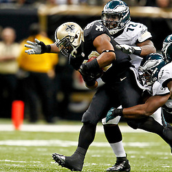 November 5, 2012; New Orleans, LA, USA; New Orleans Saints running back Mark Ingram (28) is tackled by Philadelphia Eagles defenders Philadelphia Eagles defensive tackle Cedric Thornton (72), middle linebacker DeMeco Ryans (59) and defensive back David Sims (21) during the second half of a game at the Mercedes-Benz Superdome. The Saints defeated the Easgles 28-13. Mandatory Credit: Derick E. Hingle-US PRESSWIRE