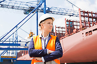 Confident female engineer in shipping yard