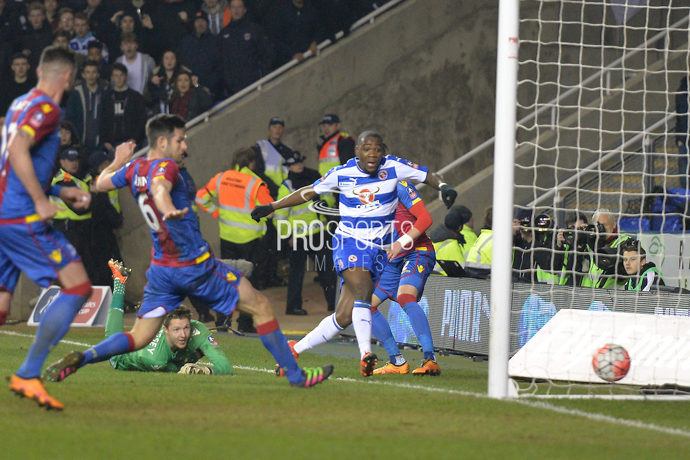 Reading FC striker Ola John puts the ball into the side netting as Crystal Palace goalkeeper Wayne Hennessey looks on during the The FA Cup Quarter Final match between Reading and Crystal Palace at the Madejski Stadium, Reading, England on 11 March 2016. Photo by Mark Davies.