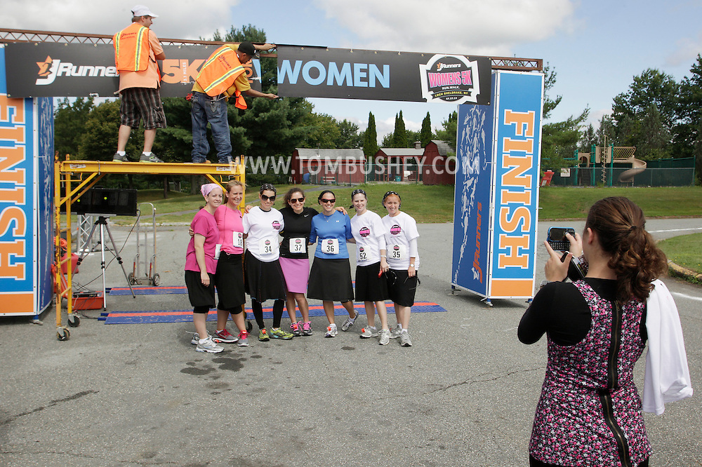 A group of women pose for a photograph before the start of the Jrunners 5K Run Walk for Women at Sullivan County Community College in Loch Sheldrake on Wednesday, July 27, 2011.  Many competitors in the race were Orthodox Jewish residents living at summer homes or bungalows in Sullivan County.