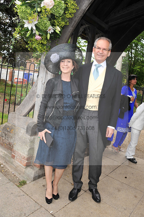 The Wedding of Sam Waley-Cohen to Miss Annabel (Bella) Ballin at St Michael & All Angels Church, Lambourn, Berkshire on 11th June 2011.<br /> Picture Shows:- Mr and the Hon Mrs Robert Waley-Cohen parents of the groom.