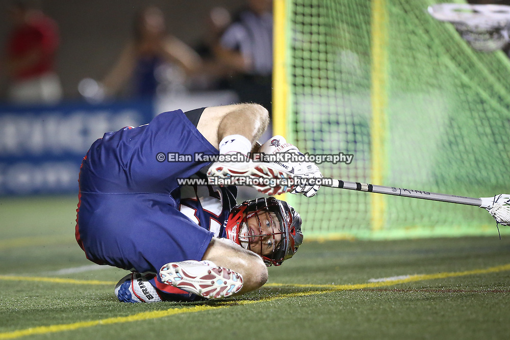 Kevin Buchanan #27 of the Boston Cannons false to the ground during the game at Harvard Stadium on August 9, 2014 in Boston, Massachusetts. (Photo by Elan Kawesch)
